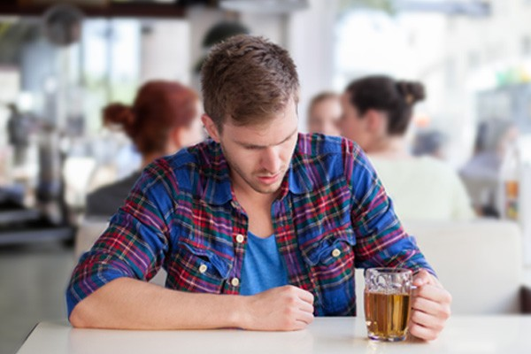 Man drinking alcohol wonders how to quit drinking