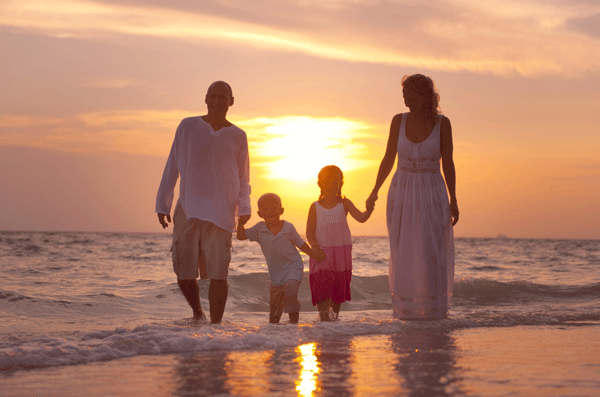 Sober parents and children on beach