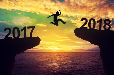 image of man jumping into 2018 to symbolize new year resolutions