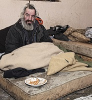 poor homeless man suffering from addiction