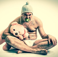 man in baby costume to symbolize the way we infantilize addiction