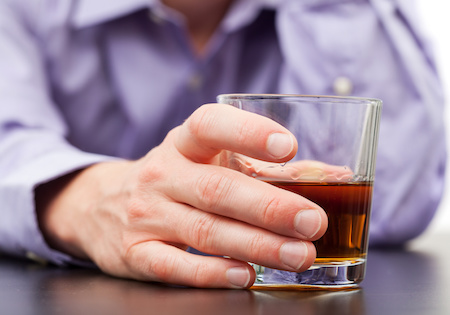 Businessman drinking with addiction