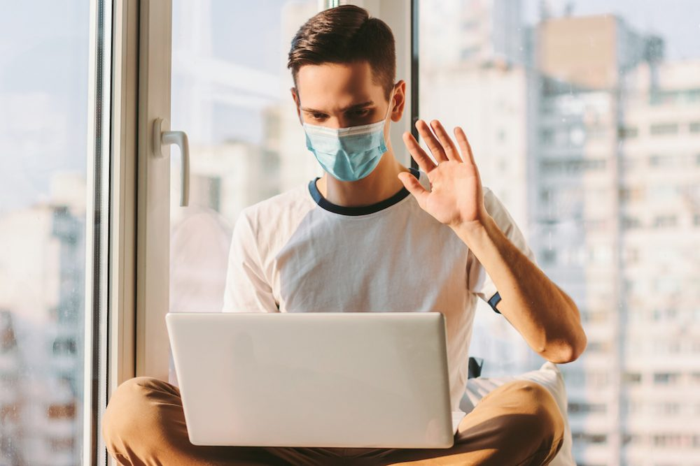 Man attending telehealth during the pandemic to curb addiction